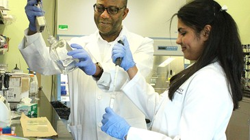 Professor and pharmacy student do research in lab