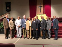 10 area pastors pictured in front of pulpit